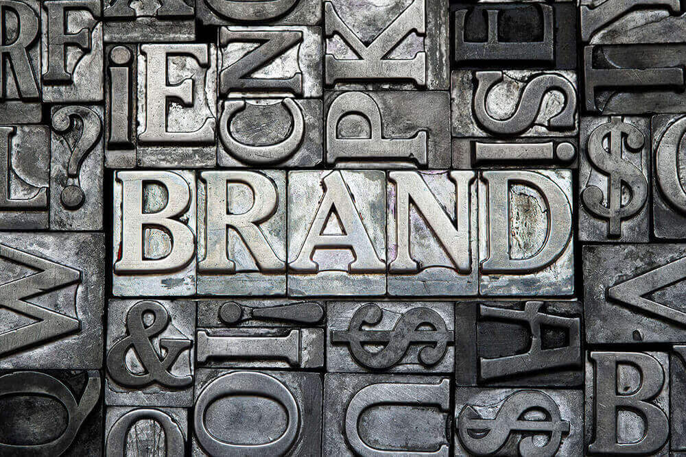 Outlay of image that focuses on the word BRAND and represents BRANDING on our website