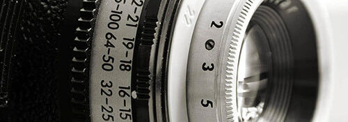 image of a camera lense to represent how we incorporate visual media in our busines